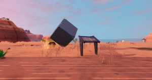 FORTNITE LOCATION OF WHERE TO VISIT A MEMORIAL TO A CUBE IN THE DESERT